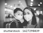 Small photo of Coronavirus covid-19 concept.Little chinese boy with mother wearing N95 mask for protect from coronavirus for back to school.School kid go to school with mom.New normal lifestyle post coronavirus.