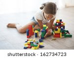 Child Playing With Blocks At...