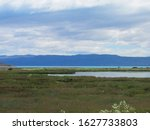 Small photo of Patagonian landscape encompassing Nimez Lagoon, Argentino Lake and the Andes mountaing range in a sunny day.