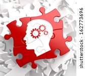 Stock photo psychological concept profile of head with cogwheel gear mechanism located on red puzzle 162773696