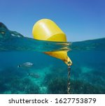 A yellow beacon buoy in the sea ...
