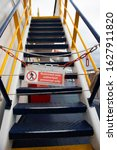 """Small photo of The inscription """"restricted area authorized personnel only"""" on the stairs of the liner. Chain-locked staircase. Prohibiting sign. Closed passageway"""