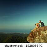 male hiker with backpack... | Shutterstock . vector #162809540