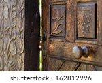 Open Wooden Door With Carved...