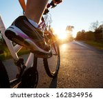 foot on pedal of bicycle | Shutterstock . vector #162834956