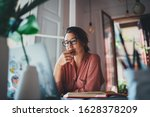 Small photo of Young businesswoman thinking about something while sitting front open portable laptop computer reading email from client, long hours of work concept