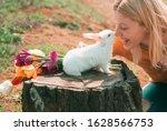 Lovely Woman Hold White Rabbit. ...