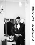 young and handsome groom... | Shutterstock . vector #1628580013