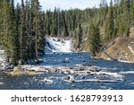 Streaming River With Waterfall In Yellowstone National Park(Lewis Falls)