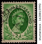 Small photo of RHODESIA AND NYASALAND - CIRCA 1954: post stamp 2 Southern Rhodesian Penny printed by Waterlow & Sons Ltd., London, shows British Queen's Elizabeth II portrait, circa 1954