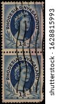 Small photo of RHODESIA AND NYASALAND - CIRCA 1954: Se-tenant stamp 1 Southern Rhodesian Penny printed by Waterlow & Sons Ltd., London, shows British Queen's Elizabeth II portrait, circa 1954