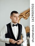 handsome groom in the home near ... | Shutterstock . vector #1629005503