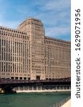 Small photo of CHICAGO, ILLINOIS, U.S.A - JULY 06, 2019: The Merchandise Mart building, situated on the Chicago River, occupies more than 4 million square feet or the equivalent of two-and-a-half city blocks.