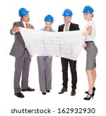 group of architects looking at... | Shutterstock . vector #162932930