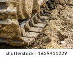 Tracks Of A Excavator Machine...