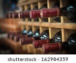 red wine bottles stacked on... | Shutterstock . vector #162984359