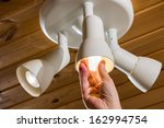 a man changes an electric light ... | Shutterstock . vector #162994754