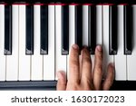 Small photo of right hand playing a F Major chord on the piano