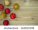 Christmas Ornaments On Wooden...