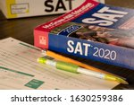 Small photo of Grand Prairie, TX/US Jan 2020: SAT prep books with scantron sheets and pencils. The SAT is a test that young students take for colleges