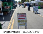 Small photo of Canoga Park, California / USA - January 25, 2020: A Certified and Non-Certified sign in front of the farmer and jewelry stands at the Canoga Park Farmer's Market on Owensmouth Ave.
