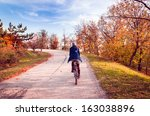 Autumn Landscape. Girl Cycling...