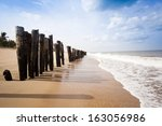 wooden posts on the beach ... | Shutterstock . vector #163056986