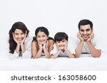 portrait of a happy family... | Shutterstock . vector #163058600