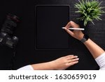 designer using stylus pen on top view - stock photo
