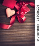 red holidays gift and heart on... | Shutterstock . vector #163086206