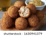 Small photo of Bitterballen are a Dutch meat-based snack, made by making a very thick stew thickened with roux and beef stock and generously loaded with meat.