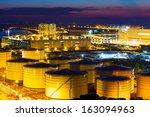 oil tanks plant during sunset | Shutterstock . vector #163094963