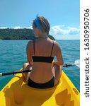 Brunette Girl Kayaking Through...