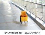 mop bucket on floor in office... | Shutterstock . vector #163099544