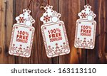 free 3d rendered christmas labels with 100 percent free download sticker in front of a nice wooden background