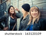 three friends woman in urban... | Shutterstock . vector #163120109