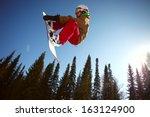 snowboarder jumping through air ... | Shutterstock . vector #163124900