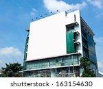 blank billboard on the building.... | Shutterstock . vector #163154630