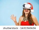 Woman Wearing Santa Claus Hat...