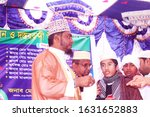 Small photo of Rangpur,Bangladesh.January 31, 2020. After memorizing the Quran, the scholars are give the boys turban.Given Turban on Stage Hafez boy the Islamic Scholar.Muslim boy and Scholar on Stage.Hujur Maulana