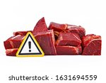 Small photo of Concept for antibiotics residue and harmful bacteria in meat for human consumption, showing chunks of red meat with yellow warning sign