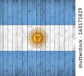 argentina flag   wood background   Shutterstock . vector #163171829