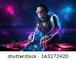 young disc jockey playing music ... | Shutterstock . vector #163172420
