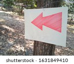 closeup red arrow on a white...