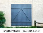 A Blue Barn Door On A White...