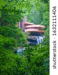 Small photo of Mill Run. Pennsylvania. USA - August, 03, 2018. Fallingwater is a house designed by architect Frank Lloyd Wright in 1935 over Bear Run waterfall. US National Historic Landmark
