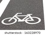 bicycle symbol on city street  | Shutterstock . vector #163228970