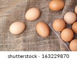 Eggs lay on sackcloth, selected focus - stock photo