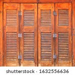 Wooden Orange Shutters On Old...