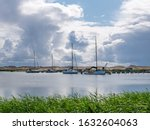 Sailboats At Jetty In Harbour...